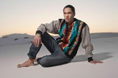 Pendleton jacket with tweed sleeves and snake skin detail by Sho Sho Esquiro (Kaska Dene/Cree). Native American designer. Photograph by Thosh Collins. Model and Actor Martin Sensmeier, Tlingit
