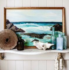 Coastal vignette in sea colors with art and bottles...