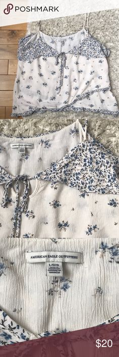 ‼️In stores now‼️American eagle floral top This is a current top in store now! The tag price is $32. I've worn it once for family photos (mom picked it out). Not my style. Front length 15in. Back length 16in. Arm pit to arm pit is 22in. It's a shift style top. It isn't a crop top, however, it is a shorter top 💕💕 absolutely adorable! No stains, stretch, or any signs of wear. Like new. Smoke free and pet free. American Eagle Outfitters Tops Tank Tops