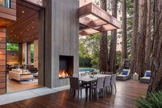 A newly built 5,000-square-foot home inspired by its natural setting among the redwood trees of Ross, Calif., is on the market for $15 million. Pictured here is an exterior deck. Photo: Jacob Elliott