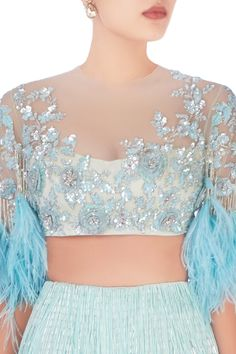 Buy Aqua blue sequin and feather design lehenga by Manish Malhotra at Aza Fashions Netted Blouse Designs, Dress Neck Designs, Princes Fashion, Saree Floral, Net Blouses, Indian Blouse, Manish Malhotra, Feather Design, Indian Attire