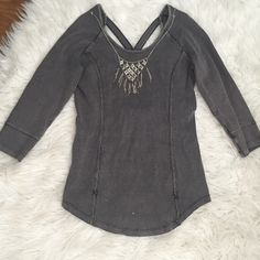 NWOT Free People Open Detailed back A unique and trendy free people half sleeves top that has a nice stretch to it. There is a unique opening in the back that makes this top to die for! NWOT. Never worn just took the tags off. It is unfortunately to big on me other wise I would keep it. :( Necklace not included. I bundle, just ask or use the bundle feature! Free People Tops