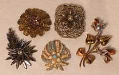 Group of Five Metal Brooches : Lot 274