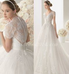 Wedding dress with thin lace and covered buttons