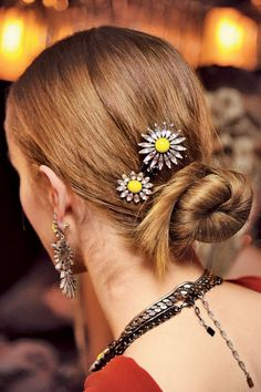 J: Jewelry for Your Updo A cluster of star-shaped pins is the perfect touch for this easy style. (Keep them close to a twisty bun, as at Dannijo, left.) For a drugstore version? Try Remington Flower Clips, $8, target.com.