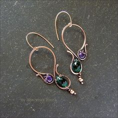 simple flowing wire frames with pretty gems inset.