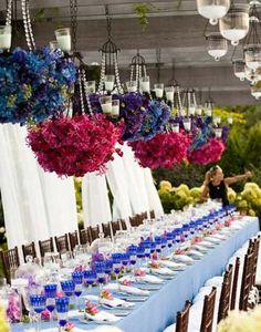 Suspended centerpieces [hops?] and chandeliers (from arbor or tent?) Long banquet style tables with simple minimal floral [beer bottles]