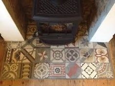 fireplace hearth tiles - mismatched tiled onto the raised concrete of constructional hearth?