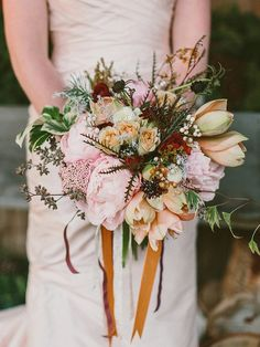 pink winter bouquet, photo by Lauren Fair Photography http://ruffledblog.com/terrain-winter-wedding #bouquet #flowers #winter
