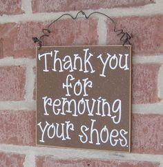 Remove shoes wooden sign