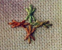 sheaf stitch; elongate the bottom stem and it would be a very pretty cross;