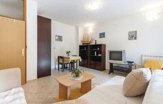 Apartment Banjole 05 Banjole Apartment Banjole 05 offers pet-friendly accommodation in Banjole, 34 km from Rovinj. The air-conditioned unit is 5 km from Pula. Free private parking is available on site.  The unit is equipped with a kitchen. A TV is available.