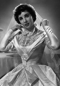 "Elizabeth Taylor's 1950 lace wedding dress she wore in the movie ""Father of the Bride"" - beautiful!"