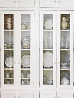 Door Inserts: Glass; White glass cabinets with white dishes  PREV  15/21  NEXT  Door Inserts: Glass        Cabinetry doors with glass fronts add an airy feel to the kitchen by breaking up the mass of wood panels. This style lets you add a decorative personal touch, too, by displaying dinnerware and collections inside.