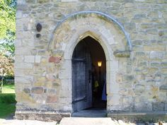 The entrance to the 12th Century leper chapel in Ripon, England. The rough-hewn door is a poor fit and the ancient lock remains.