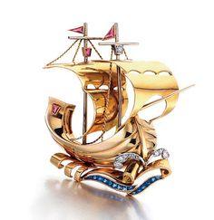 A Retro Gold, Diamond, Sapphire and Ruby Sailing Ship Brooch