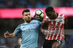 Manchester City's Argentinian striker Sergio Aguero (L) vies with Southampton's Dutch-born Curacao midfielder Cuco Martina during the English Premier League football match between Manchester City and Southampton at the Etihad Stadium in Manchester, north west England, on October 23, 2016. The game finished 1-1. / AFP / Oli SCARFF / RESTRICTED TO EDITORIAL USE. No use with unauthorized audio, video, data, fixture lists, club/league logos or 'live' services. Online in-match use limited to 75…