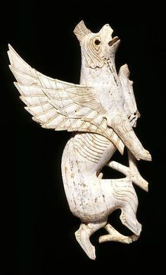 Ivory plaque of a griffin that would have been used to decorate furniture.
