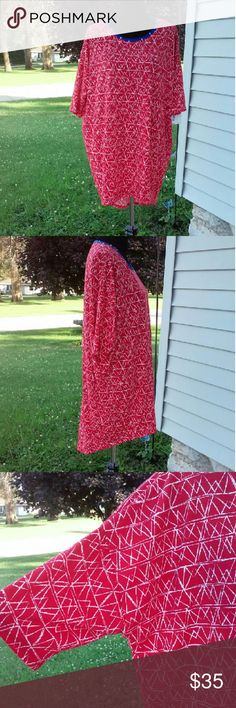 Just InLularoe Irma Tunic Lularoe Irma Tunic in red with white accents and a blue neckline. Loose, knit high-low tunic with fitted mid length sleeves. Last picture just shows the fit. New with tags. LuLaRoe Tops Tunics
