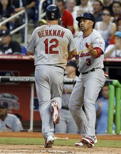 Berkman and Beltran celebrate after scoring after Freeses hit 1st game of season.   4-4-12