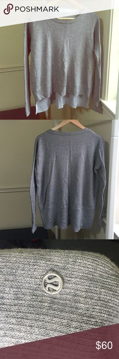 Lululemon grey sweater Soft Lululemon grey sweater in the cozier fabric! Perfect for a cold/rainy day. In good condition with minor piling on the sides of the fabric on the sides (shown in photo 4). lululemon athletica Tops