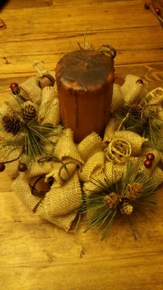 Christmas burlap candle ring- I would use a glass hurricane topper.  Too easy to catch burlap on fire......