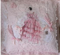 Maybe make something like this for Grace for her wedding? Maybe use some of her baby bows, my wedding dress. I will find the original source, this looks like a Robert Best Barbie art transfer...this pillow was made by Holly of Holly Loves Art...here is the link to her etsy store: https://www.etsy.com/shop/HollyLovesArt?ref=pr_shop_more