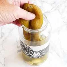 That's not a pickle it's a Hatch chile! Before you throw out the pickle juice at the bottom of the jar use it to pickle some roasted skinned Hatch chiles for your sandwich. It's a pickle and chile fusion match-up and you want it.  Think of it like a cheater's pickle. Just let the Hatch sit in that brine in the refrig for a couple of days. Then fish one out pat it off and deploy in your favorite sandwich.  Lunch will never be the same.  I went to a @melissasproduce  #Hatchchiles roasting on the w