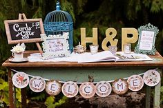 Welcome table    Garden Tea Party Wedding   Photography: Courtney Bowlden Photography   Event Designer & Coordinator: Perfectly Posh Events  Venue: Robinswood House    Flowers: Sublime Stems    Cake: Midori Bakery    Caterer: Herban Feast    Prop/Furniture Rentals: Vintage Ambiance    The Wedding Chics