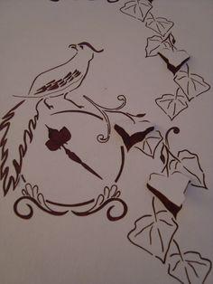 Bird and clock motif - laser cut wallpaper