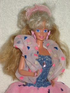 Got to love the 80's hair the barbies had!