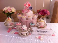 Vintage tea time inspired two tier cake and matching cupcakes
