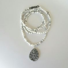 Back in stock, popular Howlite beaded wrap necklace with a sparkly grey druzy pendant. Generous length can wrap easily plus the pendant can be moved along for various styling or removed and changed out with another pendant. Come see. annaleahcustomdesign