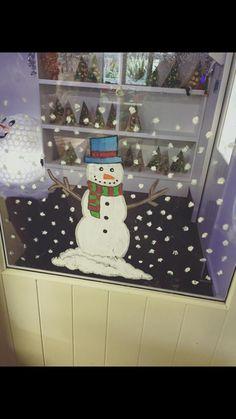 Santa's grotto, snowman, window art.