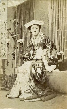 https://flic.kr/p/ppdCYC | Twelve Transfigurations of a Geisha - September 1870s | September 九月 kugatsu, the long month. Meigi (famous geisha) Era Kayo, wearing a tsuno-kakushi headdress, originally worn by wealthy women to protect their hair from dust.