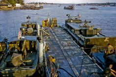 The Vietnam War Era — US Navy boats on the Mekong River in My Tho, circa...