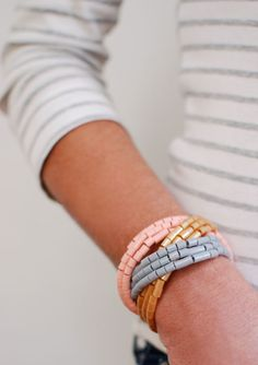 Thread inexpensive perler beads onto wire to make this chunky tricolor statement bracelet. | 5 Incredibly Clever DIYs You'll Actually Want To Try