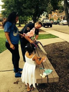 A police officer repairs a little girl's bike!