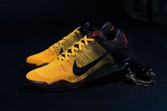 Nike has unveiled Kobe Bryant's latest signature model, the Kobe 11 Elite Low Bruce Lee, which pays homage to martial arts' most recognized personality. Popular Sneakers, Sneakers For Sale, Air Max Sneakers, Sneakers Nike, Nike Shoes, Bruce Lee, Nike Basketball, Kobe Bryant, Moda Sneakers