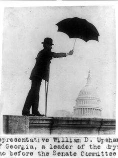 "Prohibition-supporter William D. Upshaw of Georgia had an easy enough time taking a photo rebuttal –he simply showed himself keeping the capital dry with the use of an umbrella. Upshaw was such a well-known supporter of temperance that he earned the nickname ""the driest of the drys."" In 1932, he even ran as the presidential candidate for the Prohibition Party."