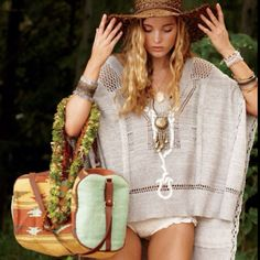 Love the hat, poncho, bag, braclets, necklace, well, just about everything!  ......she needs pants tho.