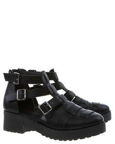 Svarta skor med breda remmar och öppen sida.Dragkedja baktill och tre spännen.