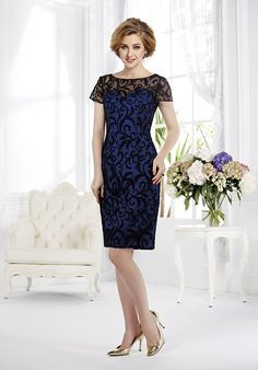 This two-toned sheath dress is also available in floor-length and features a delicate lace overlay with illusion neckline and short sleeves..