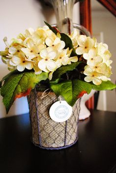 Antique White Hydrangea floral arrangement on a chicken wire basket with burlap. Perfect for a house warming, birthday or mother's day gift. Inexpensive Flower Arrangements, Floral Arrangements, Craft Ideas, Decor Ideas, Chicken Wire, Wire Baskets, Thanksgiving Ideas, Art Floral, Floral Bouquets