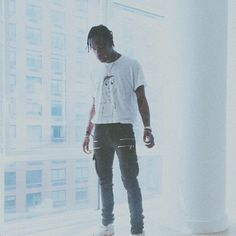 Travis Scott Draped In Olivier Rousteing's Balmain Clothes- http://getmybuzzup.com/wp-content/uploads/2014/11/391969-thumb.png- http://getmybuzzup.com/travis-scott-draped-olivier-rousteings-balmain-clothes/- By Don Bleek Rapper, producer and fashion trendsetter Travis Scott was spotted draped in Olivier Rousteing's Balmain clothes. In the picture above, he styled a white tee-shirt with $1,345 Balmain Biker Cargo Pants and Nike sneakers. These luxe skinny cargo pants featu