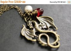 HALLOWEEN SALE Dragon Necklace. Bronze Draco Necklace with Red Teardrop and Fresh Water Pearl. Handmade Jewellery. by TheTeardropShop from The Teardrop Shop. Find it now at http://ift.tt/2f3o6a4!