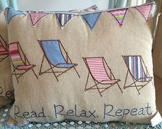 Seaside-Nautical-Cushions-Natural-Background-with-Beach-Huts-or-Deckchairs