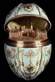 Gatchina Palace Egg - When opened up, the egg reveals the surprise, a miniature replica of the Gatchina Palace, the Dowager Empress' principal residence outside St. Petersburg. The miniature is fixed inside the egg, and cannot be removed from it.