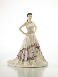 Brimming with confidence, beautiful Melissa is wearing a simple yet stylish gown that's perfect for a party or celebratory ball.  Melissa is a thoroughly 'Modern Young Miss' and reflects the wide appeal of the English Ladies Co figurines both as mementos of important occasions and as gifts for 21st century homes.