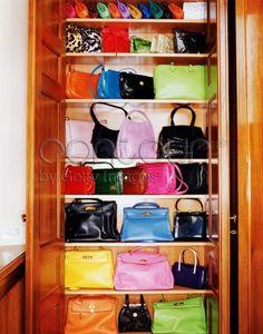 Donatella's hangbag closet - love all the Hermes in acid colours